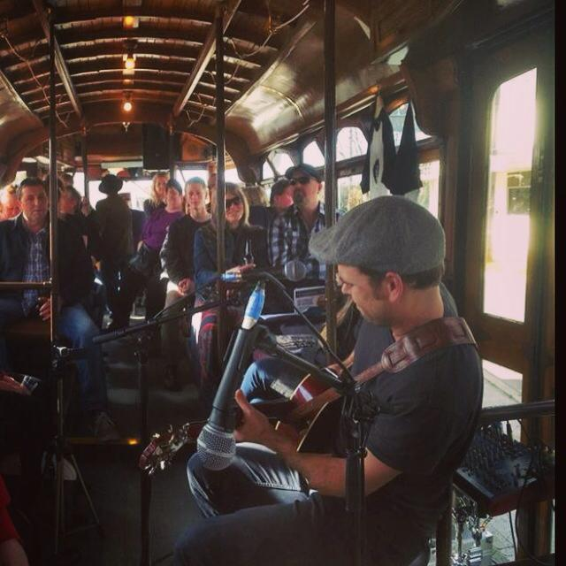 Luke Watt performing on The Blues Tram